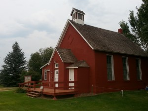 An exterior shot of the Little Red School House